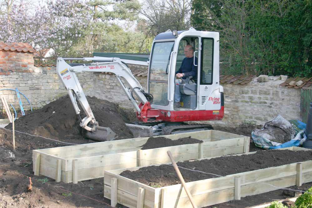 Garden Railway - more stone, levelling and raised beds for Mrs P