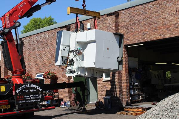 A new machine arrives in the workshop